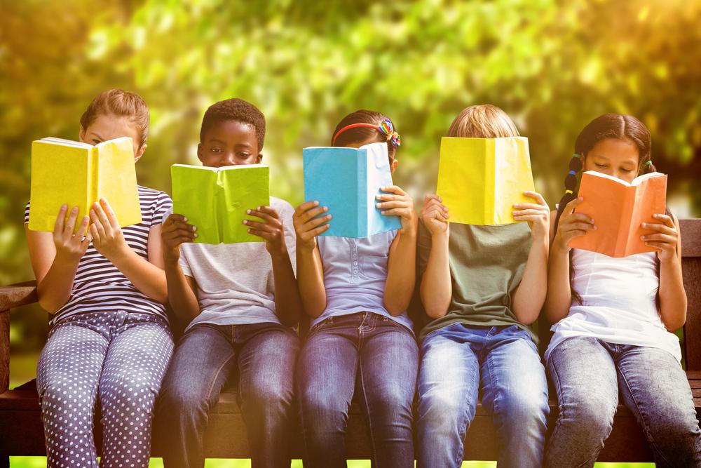 children reading books in the summer