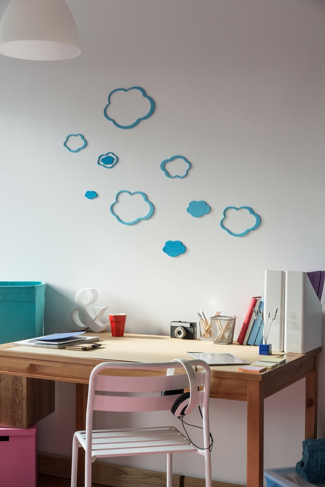 Cozy space for learning in girls room