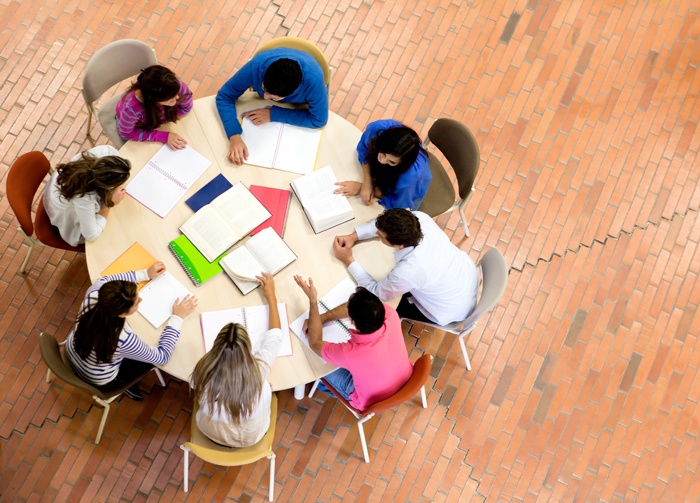 Study group with young people sitting in a round table