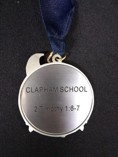 he Class 5 medal with an inscription of 2 Timothy 1:6-7