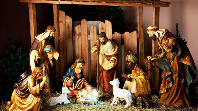 Setting up the manger at Christmas.
